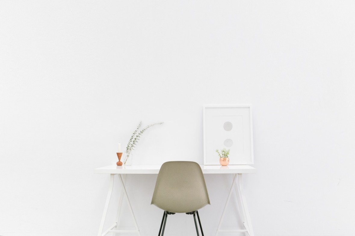 modern desk and chair against white background